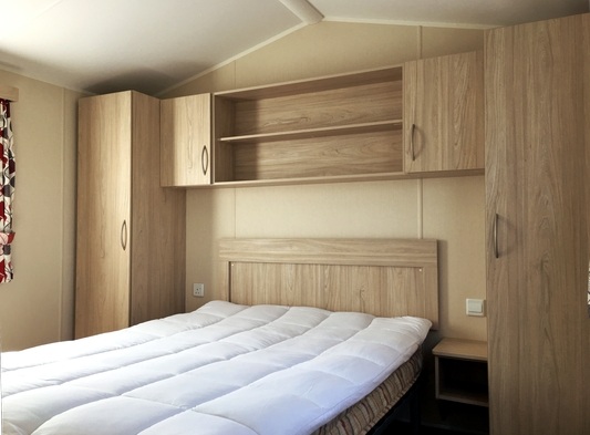 Photo of the main bedroom in one of our holiday caravans
